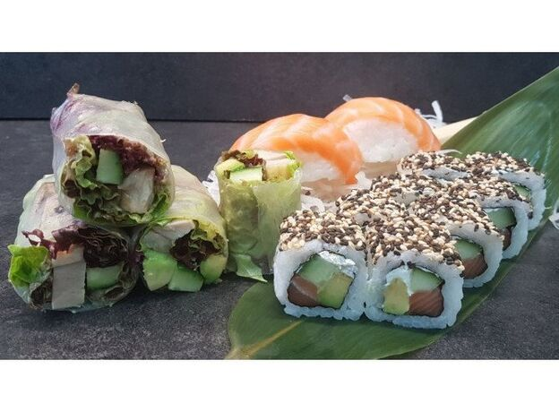 Sushi and duck in rice paper
